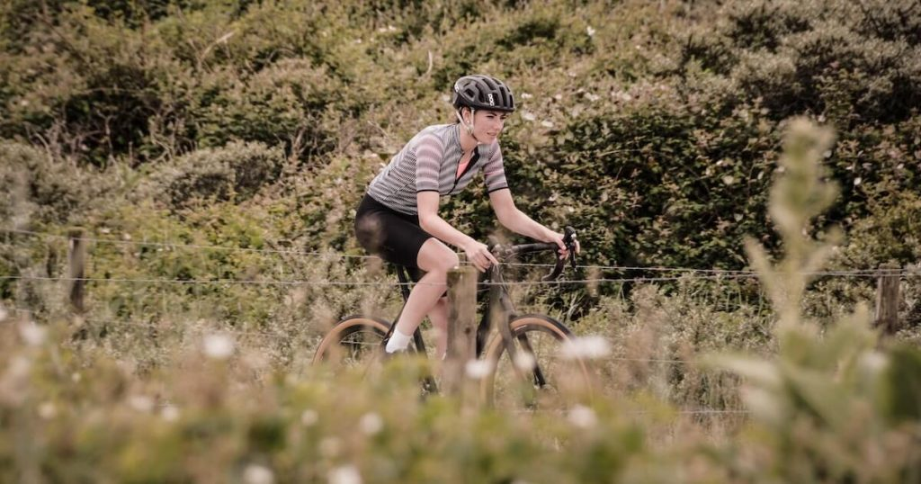 A woman on a gravel bike in a nature