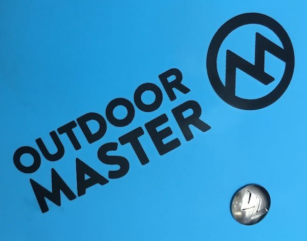 OutdoorMaster logo and branded rivet in detail