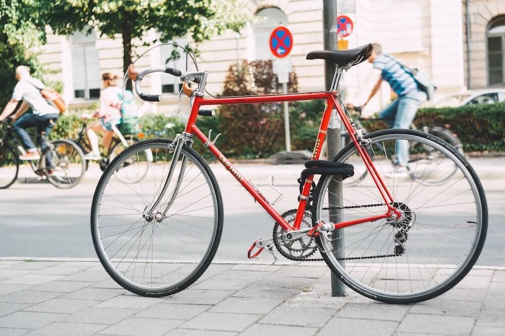 Locked red steel road bike